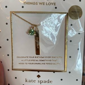 "Kate Spade August necklace with ""Lady Luck"""